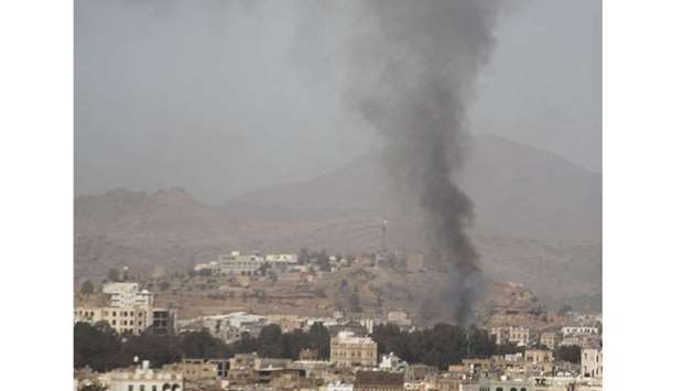 Smoke rises after an air strike in Sanaa, Yemen yesterday.