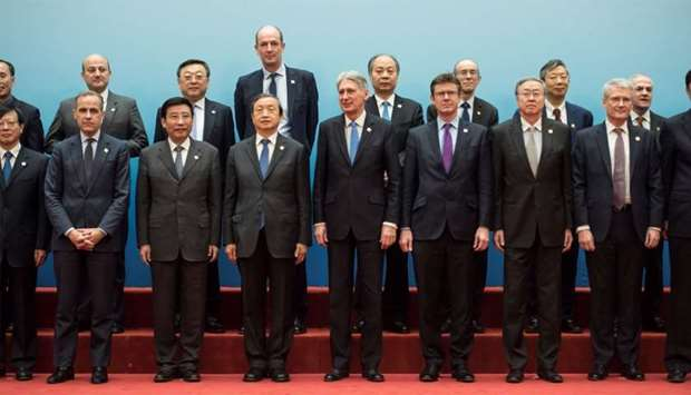 Britain's Chancellor of the Exchequer Philip Hammond and Chinese Vice Premier Ma Kai pose with deleg