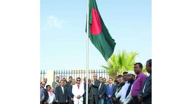 Ambassador Ashud Ahmed hoisting the national flag on the occasion of the 47th anniversary of Banglad