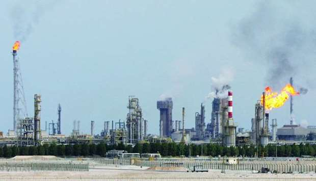 This file photo taken on February 1, 2006 shows an oil refinery on the outskirts of Doha. On a yearl