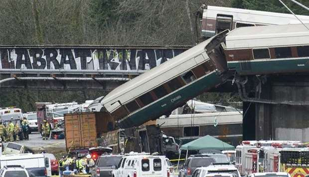 The scene of a portion of the Interstate I-5 highway after an Amtrak high speed train derailled from