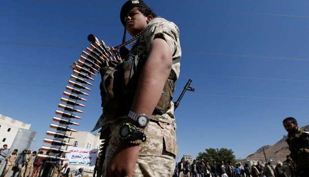 Houthi militant takes part in a parade