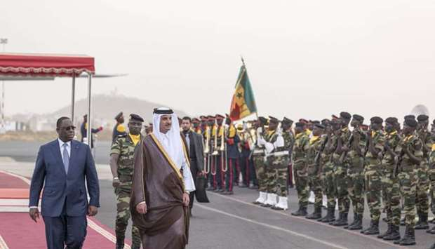 His Highness the Emir Sheikh Tamim bin Hamad al-Thani inspects guard of honor during the official re