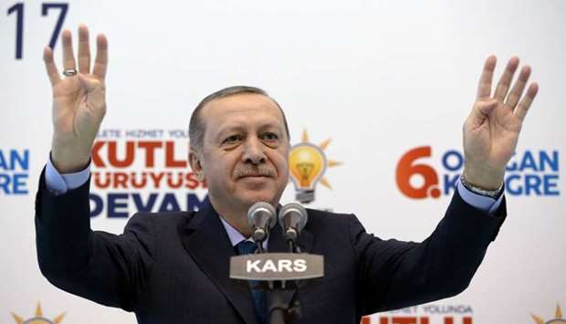 Turkish President Tayyip Erdogan greets his supporters during a meeting of his ruling AK Party in Ka
