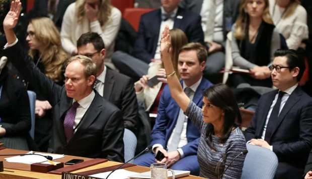 US Ambassador to the United Nations Nikki Haley votes among other members of the United Nations Secu