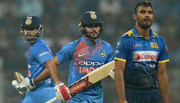 Indian batsmen Manish Pandey (C) and Shreyas Iyer (L) run between the wickets during the third T20 i