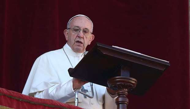 """Pope Francis leads the """"Urbi et Orbi"""" (to the city and the world) message from the balcony overlooki"""