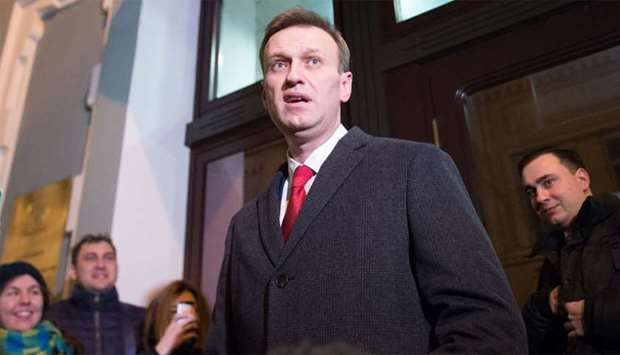 Russian opposition leader Alexei Navalny speaks to the media