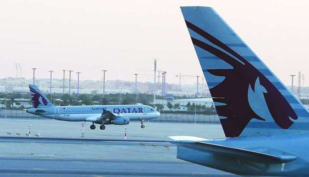 A Qatar Airways plane lands at the Hamad International Airport. Qatar's national carrier is one of t