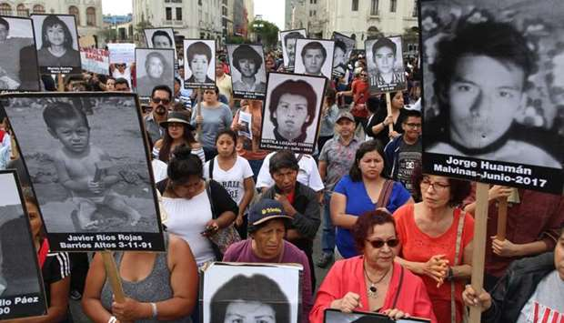 People hold a protest against humanitarian pardon to Peru's jailed ex-president Alberto Fujimori, in