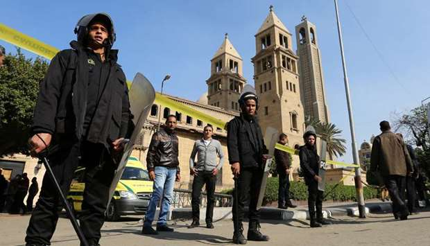 Members of the special police forces stand guard to secure the area around St. Mark's Coptic Orthodo