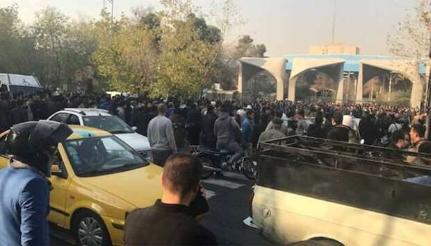 People protest near the university of Tehran, Iran