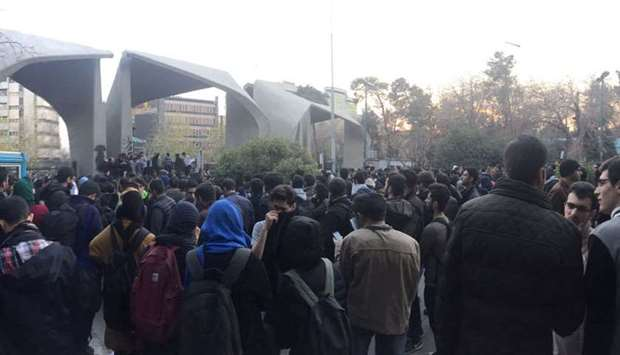 People protest near the University of Tehran, yesterday, in this picture posted on social media.