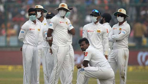 Sri Lanka cricket players wear masks in an attempt to protect themselves from air pollution