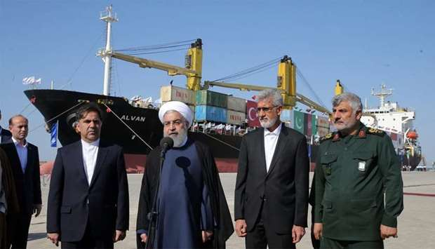 Iranian President Hassan Rouhani (C) inauguraiting the first phase of Chabahar (Shahid Beheshti) Por
