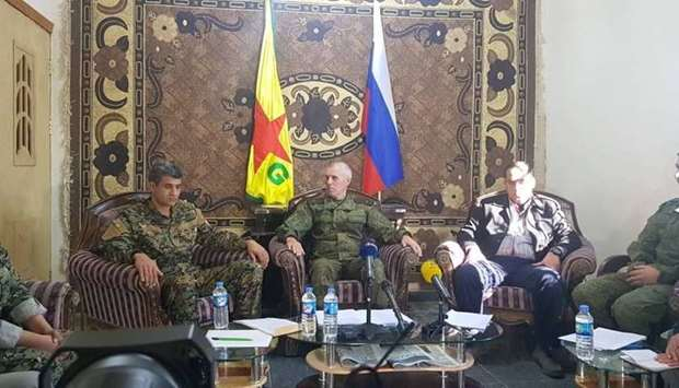 SDF and Russian officials at a joint conference press over the war agains Islamic State group in Dei
