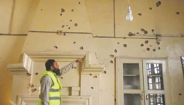 This picture taken in the aftermath of the attack on Friday morning shows a rescue worker gesturing