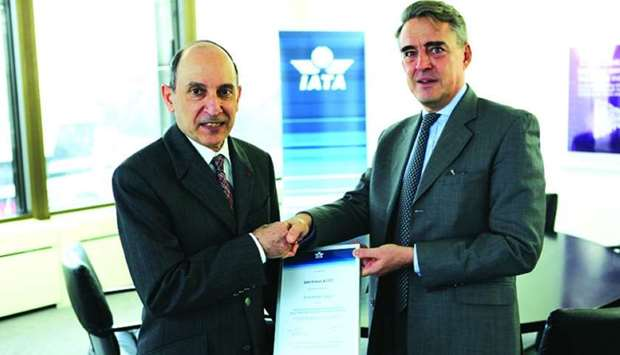 Qatar Airways Group chief executive Akbar al-Baker receiving the IEnvA Stage 2 certificate from Alex