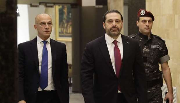 Lebanese Prime Minister Saad Hariri (C) arrives to attend a cabinet meeting at the presidential pala