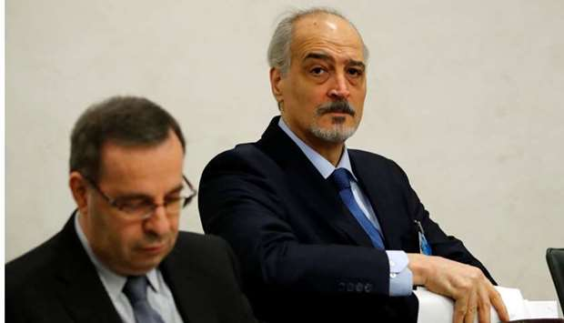Syria's UN ambassador and chief negotiator Bashar al-Ja'afari (R) arrives for a meeting with United