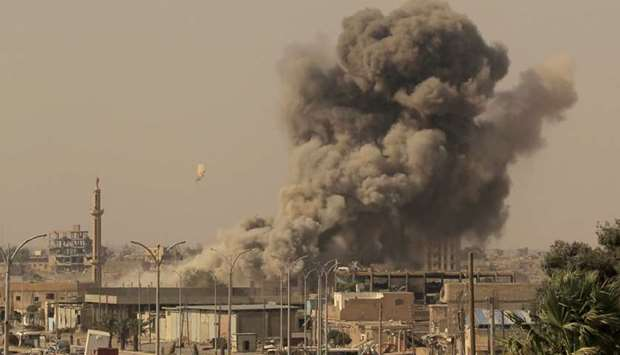 Smoke rises after an air strike during fighting between members of the Syrian Democratic Forces and
