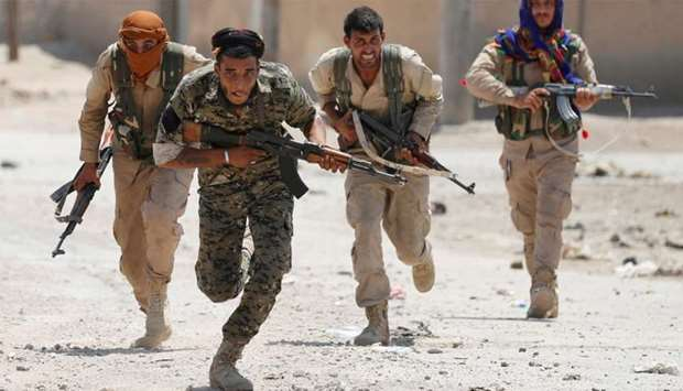 Fighters battle against Islamic State in Raqqa, Syria