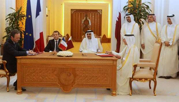 His Highness the Emir Sheikh Tamim bin Hamad al-Thani, French President Emmanuel Macron, His Highnes