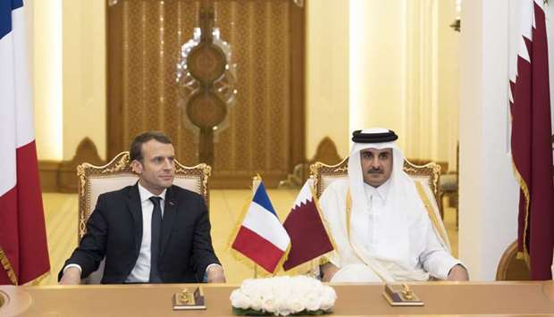 His Highness the Emir Sheikh Tamim bin Hamad al-Thani and French President Emmanuel Macron