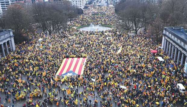 People wave a giant Catalan 'Estelada' flag during the pro-independence demonstration yesterday in B