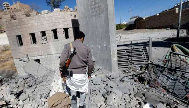 A Yemeni man looks at the damage in the aftermath of an air strike by the Saudi-led coalition on the