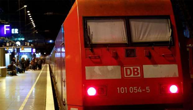 The window shades of a Deutsche Bahn locomotive are closed during a rail workers' strike across the