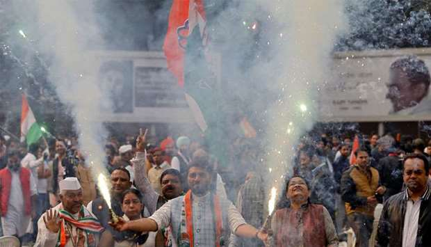 Supporters of India's main opposition Congress party celebrate after initial poll results at the par