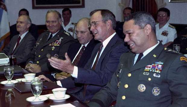 US President George H.W. Bush meets with his military advisors at the Pentagon to discuss the Gulf c