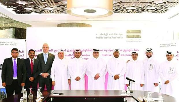 Ashghal president engineer Saad bin Ahmad al-Muhannadi and other officials with representatives of t