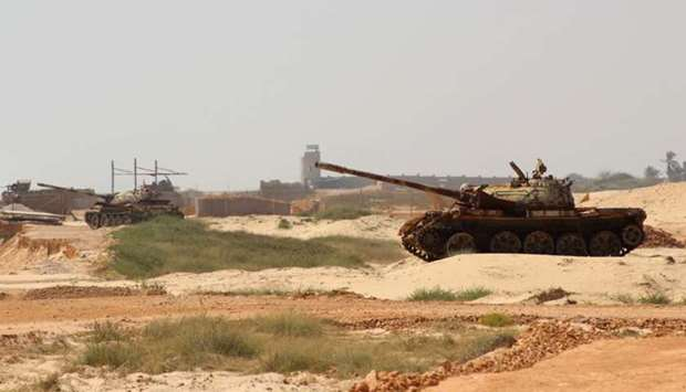 Yemeni pro-government forces tanks are positioned near Mukalla airport