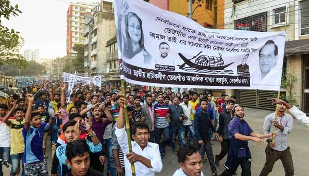 Supporters of Bangladesh Awami League march in the street as they take part in a general election ca