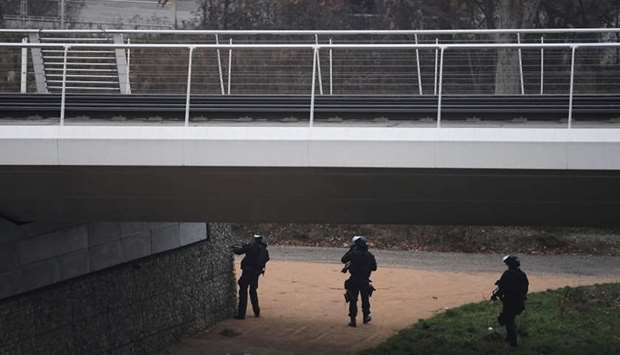 Members of the French police special forces RAID conduct searches on a bank of the river Rhine in St