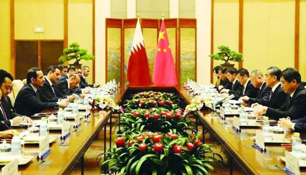 HE Sheikh Mohamed bin Abdulrahman al-Thani, and Chinese State Councilor and Foreign Minister Wang Yi