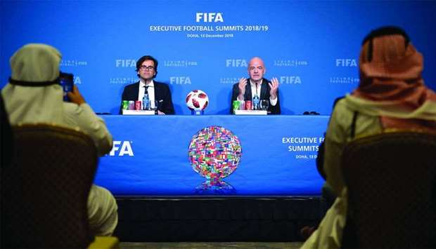 Fifa president Gianni Infantino speaks during a news conference in Doha