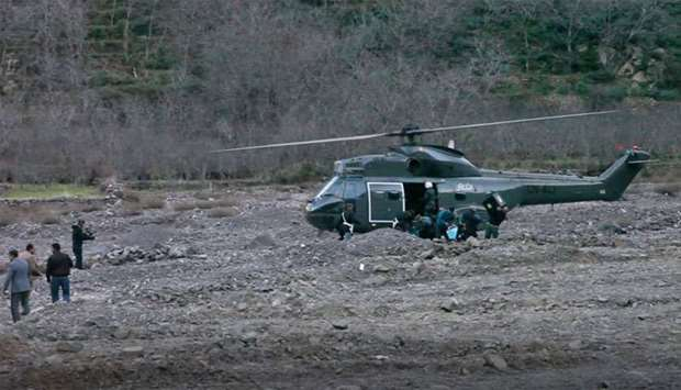 A helicopter at the scene of a crime where the bodies of two Scandinavian women were found the day b