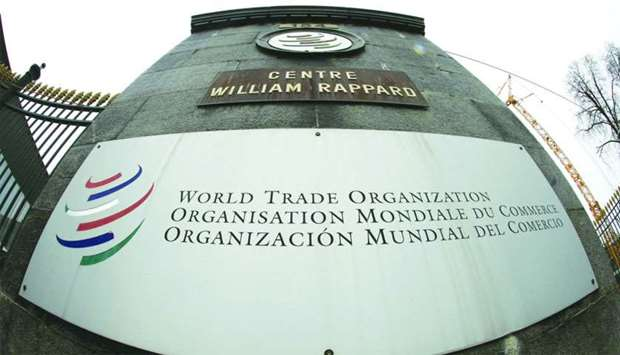The WTO logo is pictured at the entrance to its headquarters in Geneva
