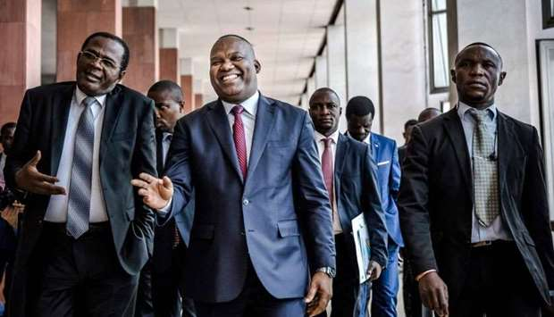 DRC's Electoral Commission President Corneille Nangaa Yobeluo (C) along with some electoral candidat