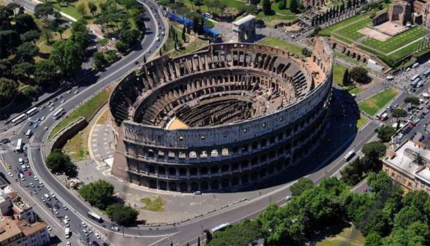 Shows the Coliseum (Colosseum, Colosseo) in Rome