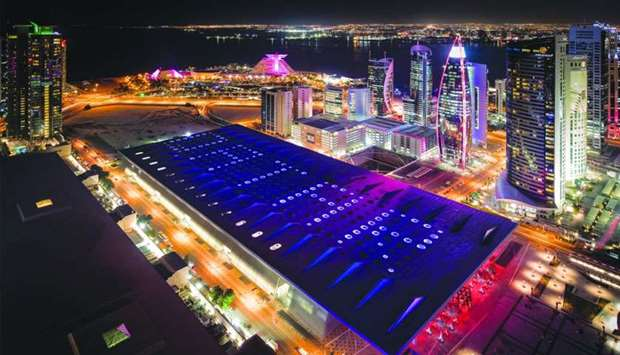 """DECC's specially-lighted roof reflected the word """"Qatar"""" during the National Day celebrations on the"""