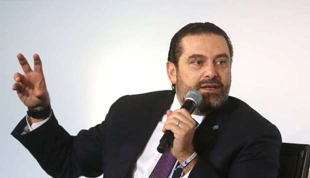 Lebanese Prime Minister-designate Saad al-Hariri gestures as he speaks during a conference in Beirut