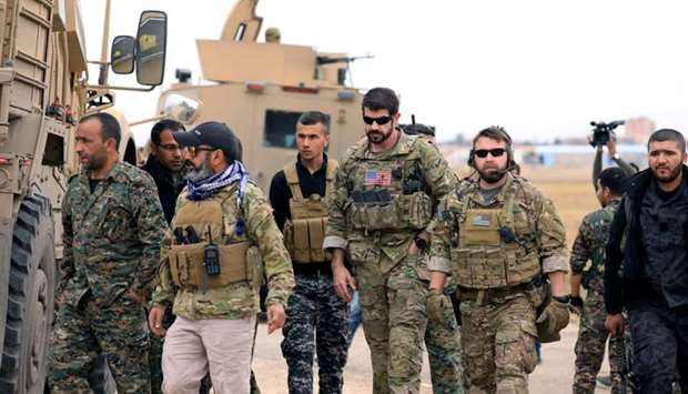 Syrian Democratic Forces and US troops are seen during a patrol near Turkish border in Hasakah