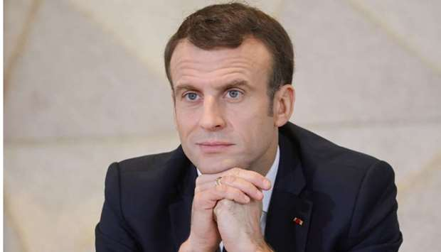 France's President Emmanuel Macron looks on during a meeting with 400 Chad women at the Women House