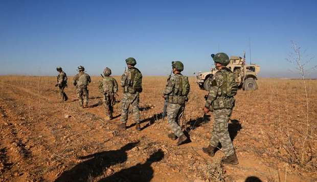 US and Turkish soldiers conduct the first-ever combined joint patrol outside Manbij, Syria