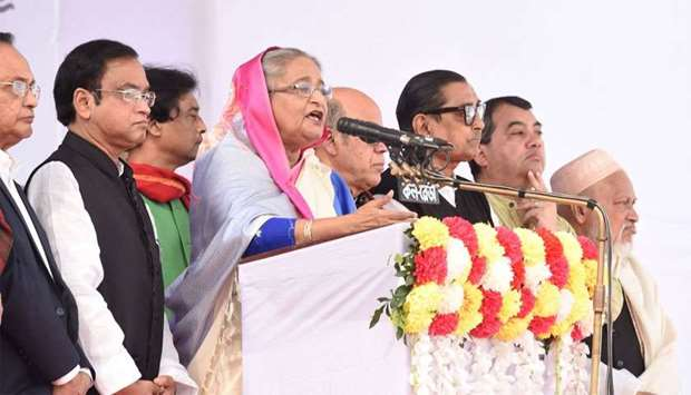 Bangladesh Prime Minister Sheikh Hasina (C) speaks during an election campaign rally in Dhaka