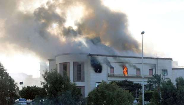 Smoke rises from the site of the headquarters of Libya's foreign ministry after suicide attackers hi